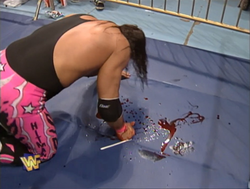 bret hart bleeding taking a beatng