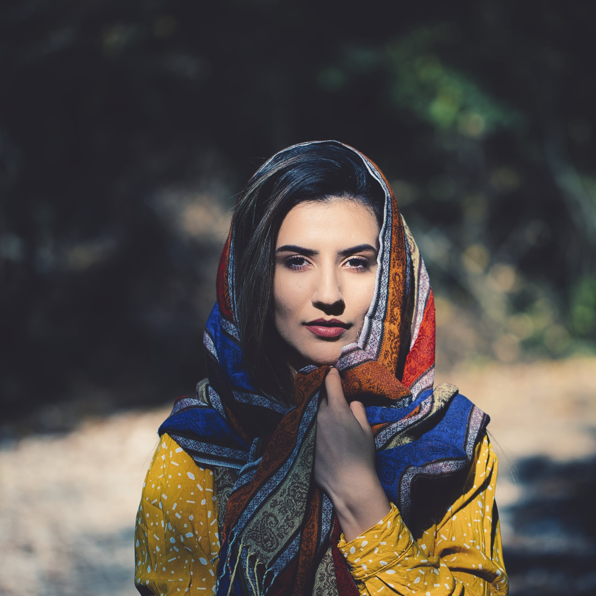 Most beautiful face in an elegant scarf and overall clothes