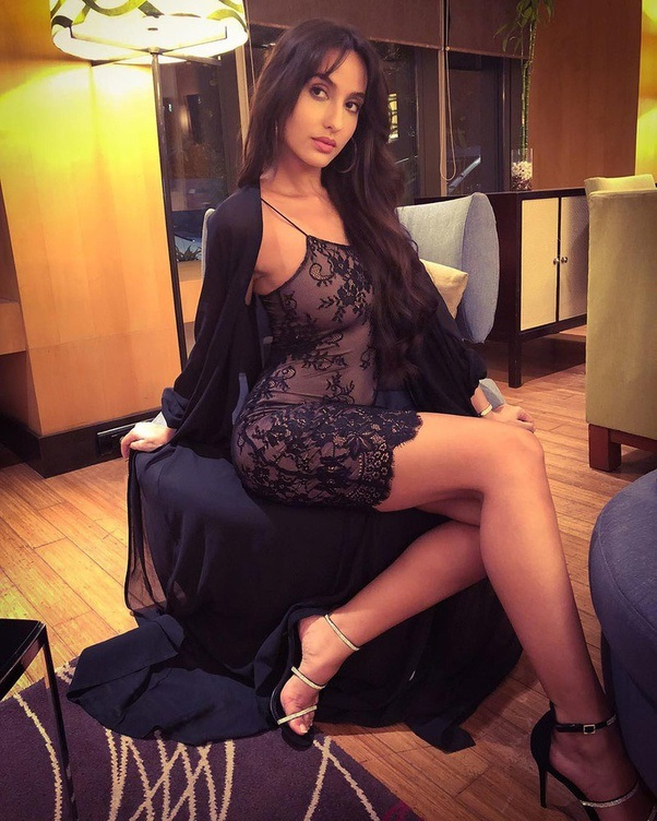 Hot and sexy Norah Fatehi in black lingerie gown