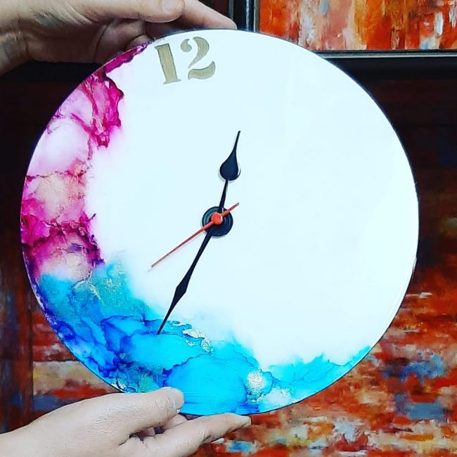 Colorful Handmade wall clock with resin coating as part of The Best Handmade Art and Craft For Your Home Decor